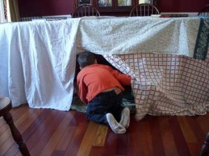 Fort or castle. Blankets or boards. Don't let anyone tell you what it should look like. (This one is from Apartment Therapy.com)